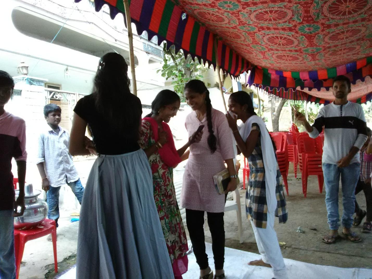 "Some girls chatting in the ""street church"" after the sermon."