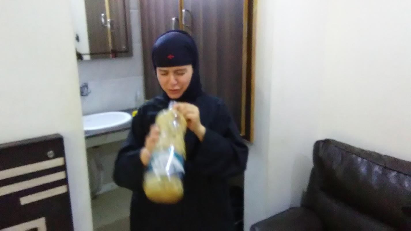 Sr. Paraskevi forcing herself to drink instant coffee without sugar or creamer