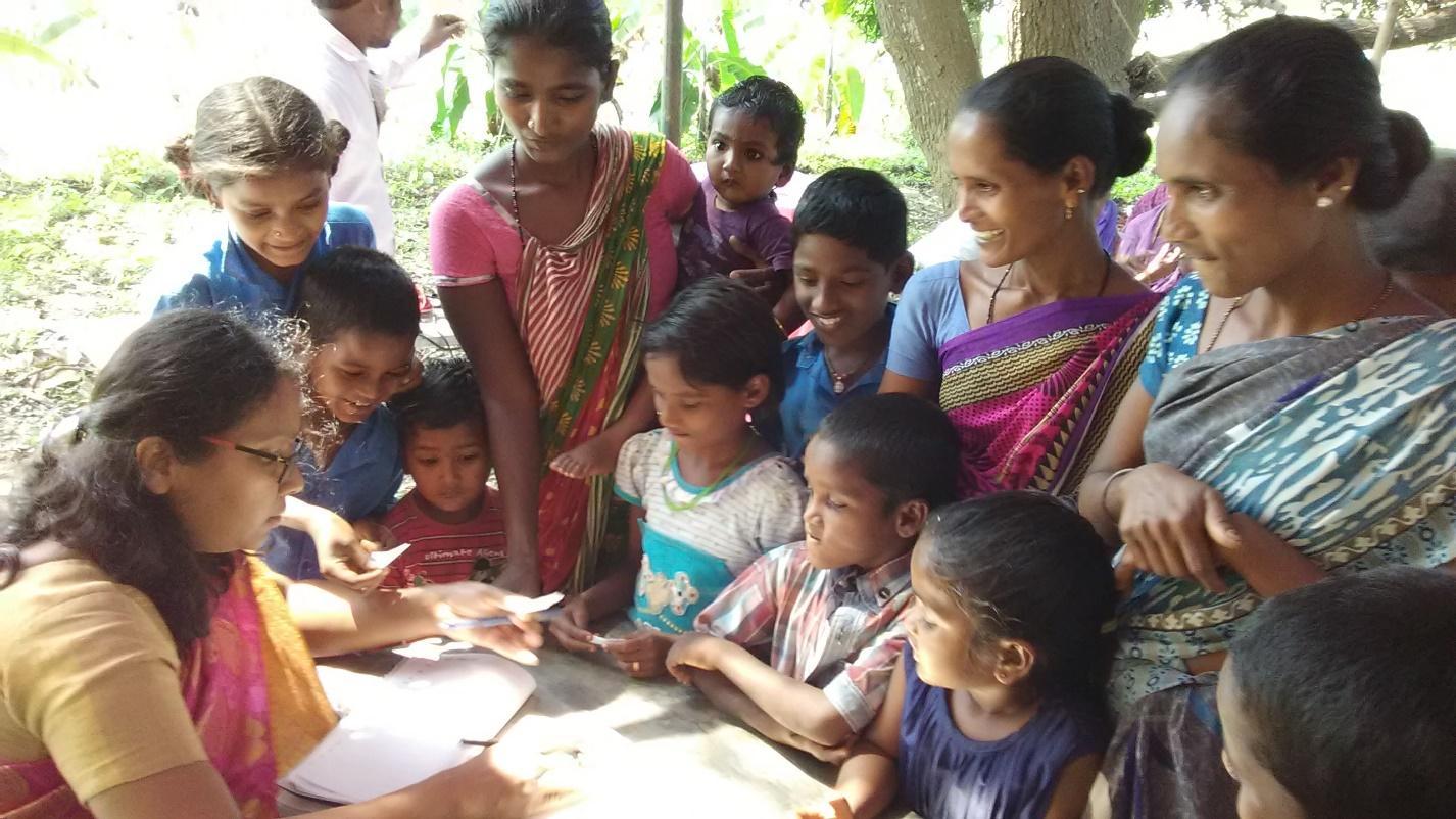 An Indian woman selecting her baptismal name